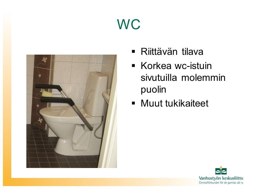 WC Riittävän tilava Korkea wc-istuin sivutuilla molemmin puolin