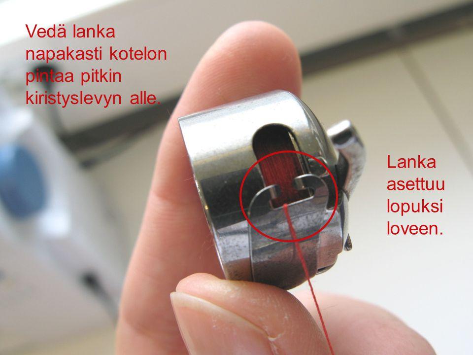 Vedä lanka napakasti kotelon pintaa pitkin kiristyslevyn alle.