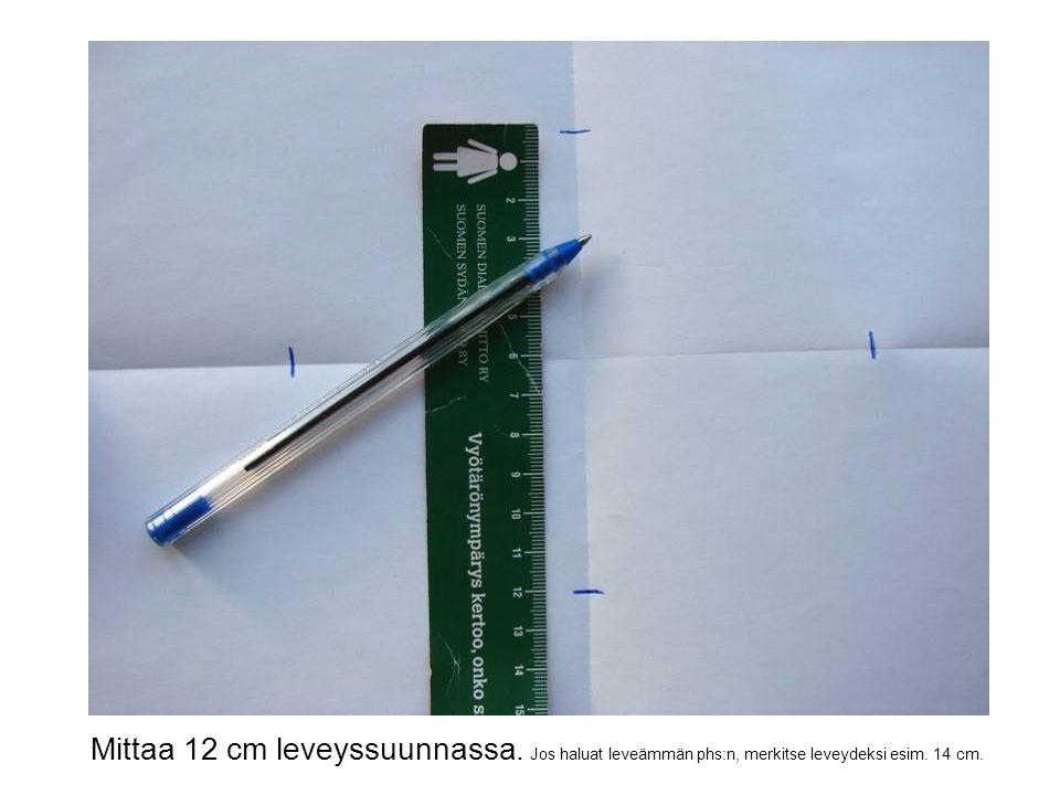 Mittaa 12 cm leveyssuunnassa